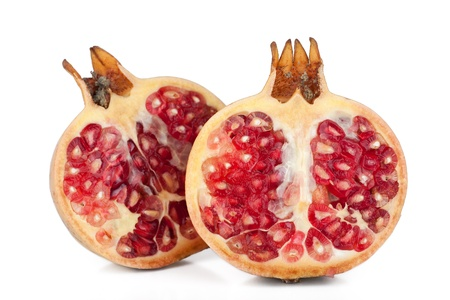 Pomegranate fruit - isolated over the black background photo