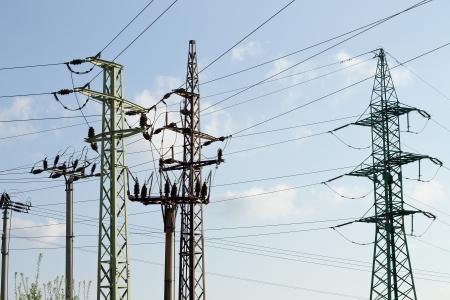 over voltage: High voltage electricity pylons over sky