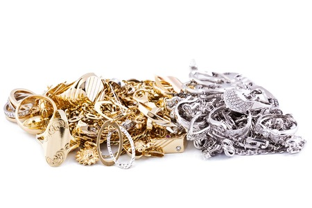 Gold jewelry on a white background photo
