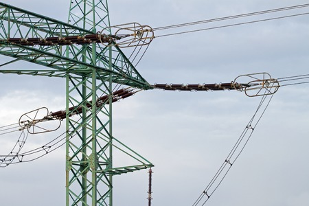over voltage: High voltage electric pylon over sky Stock Photo