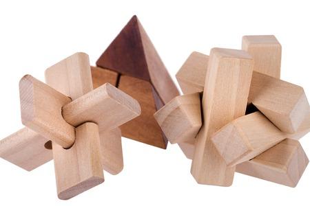 teaser: Wooden brain teasers on white background  Stock Photo