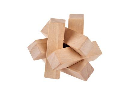 brain teaser: Wooden brain teaser on white background   Stock Photo