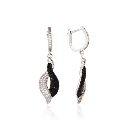 Silver earrings isolated on white background photo