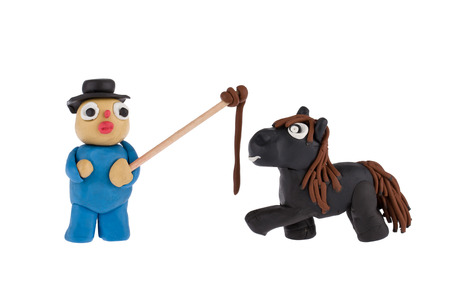 whip: Farmer and horse with whip made of plasticine