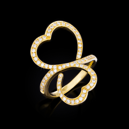 gold ring in the shape of heart photo