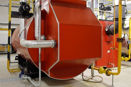 Industrial boiler room with gas boilers photo