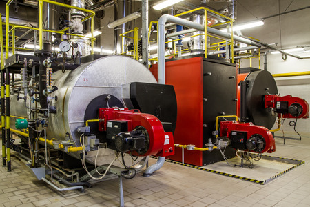 industries: Gas boilers in gas boiler room Stock Photo