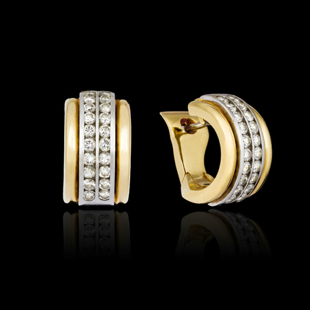 diamond earrings: Diamond earrings isolated on the black background Stock Photo