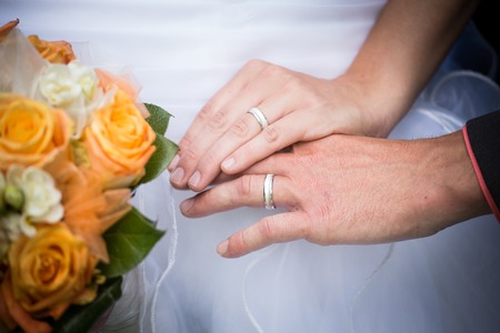 wedding ring hands: Young married couple holding hands, ceremony wedding day