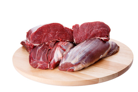 animal blood: Raw beef meat and cutting board isolated on white background Stock Photo