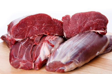 animal blood: Raw beef meat isolated on white background Stock Photo