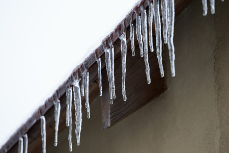 icicles: Icicles which are hanging down from a roof
