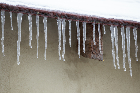 thawing: Icicles which are hanging down from a roof