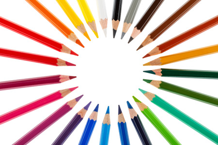 colored pencils: Colored pencils stacked in a circle isolated on white background Stock Photo