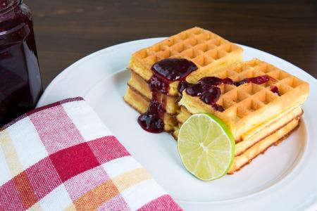 marmelade: Whole wheat waffles with marmelade Stock Photo