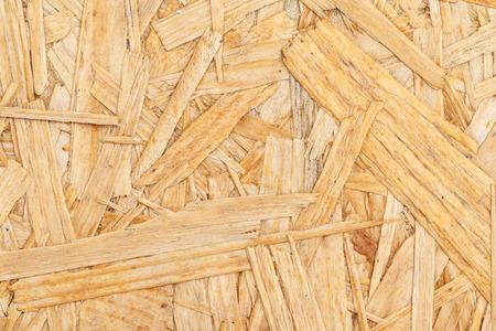 Spaanplaat. Sluit omhoog gedrukte houten paneelachtergrond, OSB-hout Stockfoto