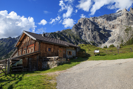 Typical mountain huts in the Austrian Alps,on a sunny day with rocky mountains in the background