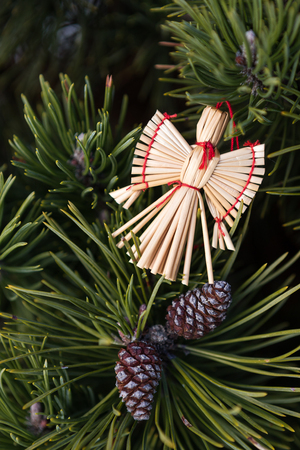 stock photo straw angel in a christmas tree christmas decorations from straw christmas angel - Christmas Angel Decorations