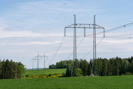 High voltage power lines with blue sky