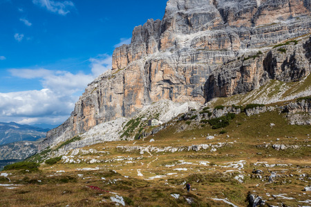 Male mountain climber on a Via Ferrata in breathtaking landscape of Dolomites Mountains in Italy. Travel adventure concept.