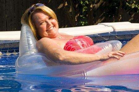 hot wife: Mature woman at the swimming pool.