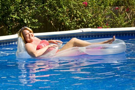 Mature woman at the swimming pool. photo