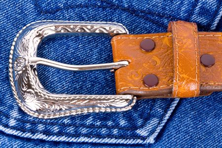 Leather belt on blue jeans. photo