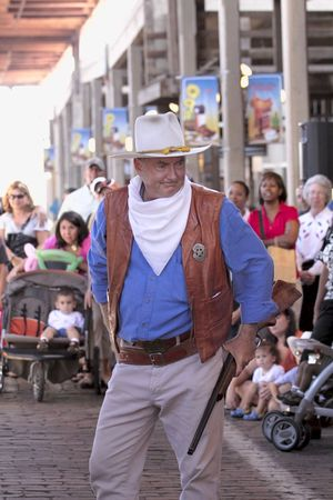 gunfighter: FORT WORTH,TX - 8302009: Actor impersonating John Wayne at Stockyards Station in Gunfighters Show.