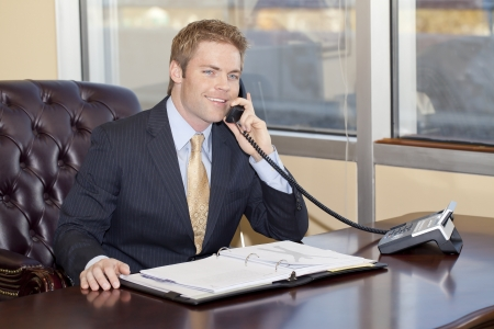 service desk: Businessman at work. Stock Photo