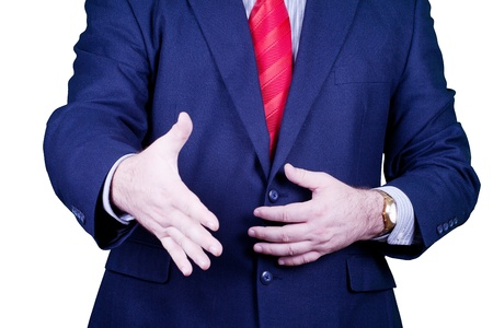 Businessman in suit and red tie handshake. Stock Photo - 10851429