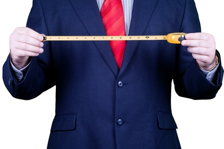 Businessman in suit and red tie measuring success. Stockfoto
