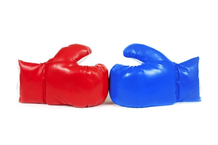 Red and blue boxing leather gloves isolated on white. Stock Photo
