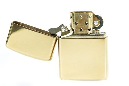 gas lighter: Golden cigarette lighter.