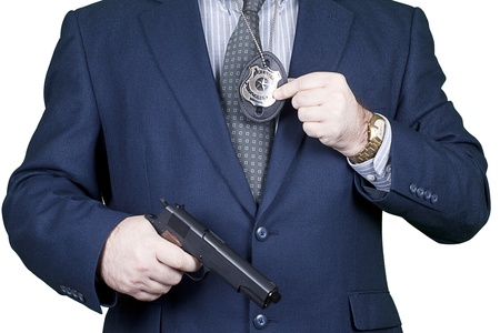 Police office with gun and badge in action Stock Photo - 11515623