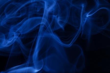 Real blue smoke on black background  Stock Photo