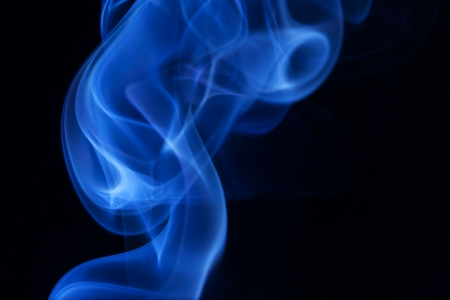 Real blue smoke on black background  photo
