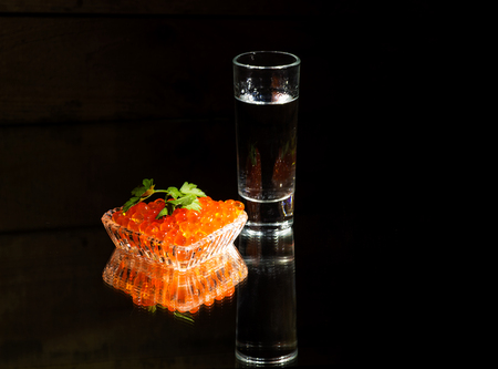 sandwiche: Still life with vodka, caviar, black bread, green olives, herbs and black bread