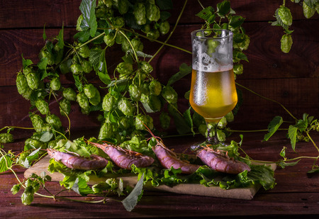 Beer with shrimps and salad on a wooden table Stock Photo