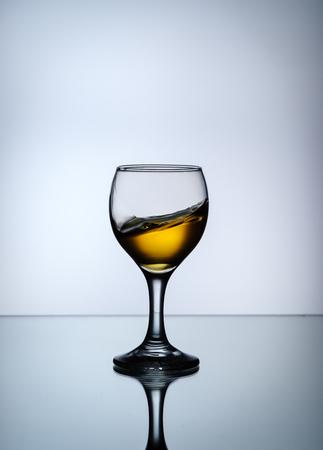 stream of wine being pouring into a glass closeup, wine, splashing, splash.