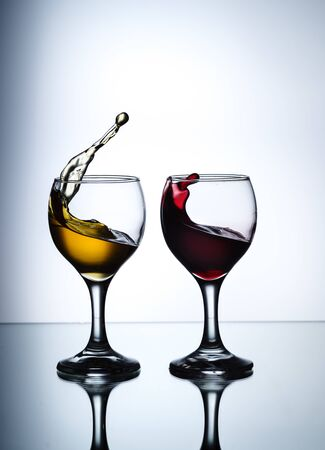 Stream of wine being pouring into a glass