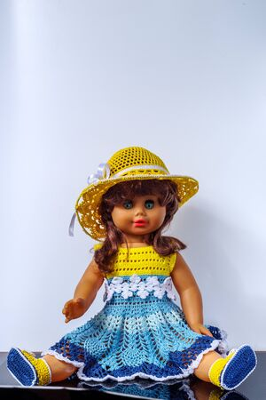 Old vintage doll in a beautiful outfit
