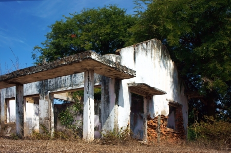 devastated land: desert house was broken, disused, ruin    making silent, fearful sence  It abandoned for a long time in devastated land