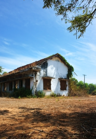 devastated: desert house was broken, disused, ruin    making silent, fearful sence  It abandoned for a long time in devastated land