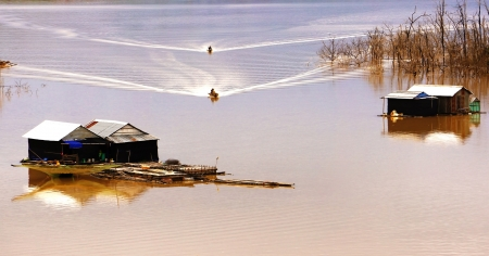 suface:  the scene of fisherman coming their lake dwelling by motor-boat at fishing village create ripplings on the water suface is so lively  This fishing village locate at NamKa lake, Dalak