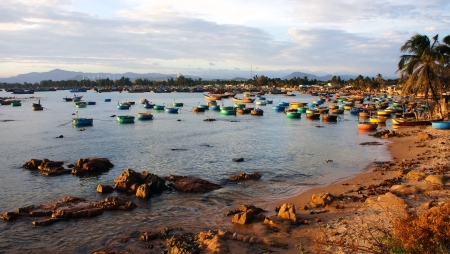 crepuscle: After day of work, fisher man attached their fishing boat at fishing port in the evening  Seascape filled golden fight, scene so beautiful  This place concentrate many many kind of boat such as  basket boat, corade, plank boat, small craft, pirogue, plywo