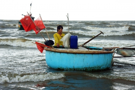 come home: This fisherman make his live by catch crab, he go out to sea at 4pm and spread a net, and come home  At 2am next morning he come back there and pick crab to sell This pic took at Ba Ria, Viet Nam, July 15, 2013
