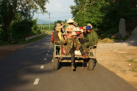 papoose: Cong Nong is one of farm vehicle of ethinic minority, after working day, all of them carry to go home by Cong Nong. Daklak, Viet Nam- September 02, 2013 Editorial