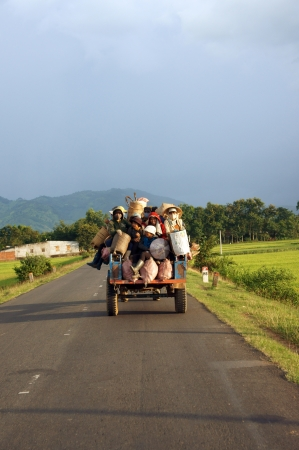 papoose: Cong Nong is one of farm vehicle of ethinic minority, after working day, all of them carry to go home by Cong Nong  Daklak, Viet Nam- September 02, 2013 Editorial