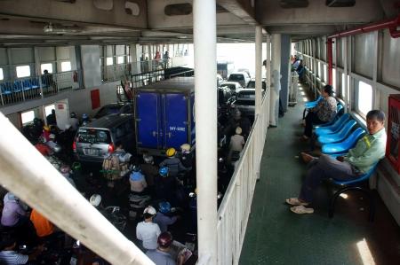 tranfer: Passenger wear helmet on motorbike at ferry boat cross the river. January 20, 2013