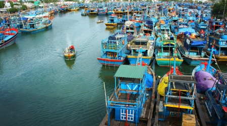 Many multicolor fishing boat anchor like a net at fishing port, with blue tone in horizontal frame. Frebruary 2, 2013